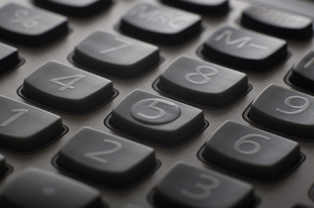 Extreme close up of calculator keys on table