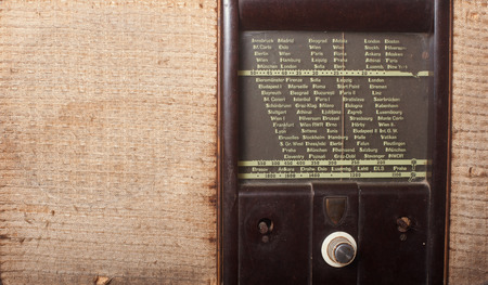dials: Close up of an old vintage radio screen with dials and stations