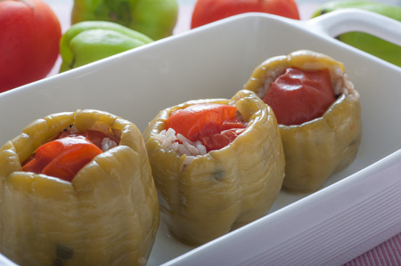 pine kernels: Turkish style stuffed bell peppers, made with green peppers, tomatoes,  rice, dried currants, pine kernels, onions, spices and olive oil. It is served cold with yogurt.