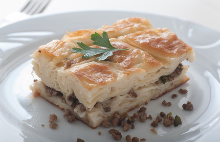 Close up of a plate of delicious Turkish borek called su boregi