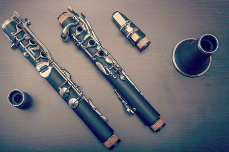 A clarinet dismantled, showings its parts on the table 写真素材