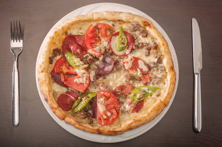 Delicious round Turkish pizza, pide with meat, cheese and peppers, viewed from above Stok Fotoğraf