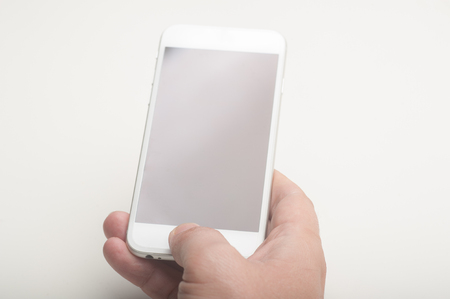 Close up of a man using a smartphone