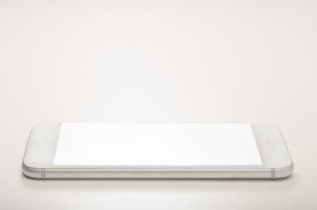A smart phone isolated on white background with empty blank screen 写真素材