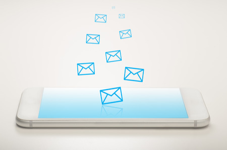 Mobile mailing concept with smart phone and mail icons showing incoming and out going mail