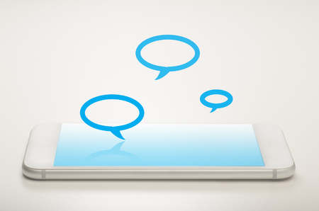 Mobile messaging concept with smart phone and speech bubles