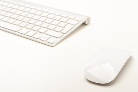 Close up of a mouse and a keyboard on a white  desktop Stok Fotoğraf
