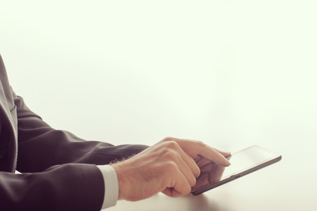 Businessman using a tablet device at the office