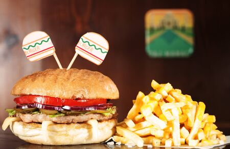 Chicken Burger on wooden table served with french fries