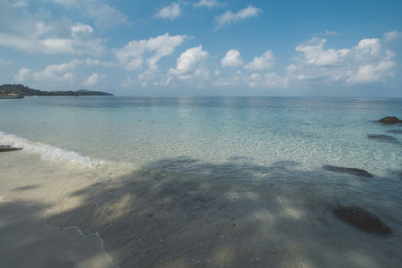 Clear Sea Water, White Sand, Cloudy Sky and Tropical Beach 写真素材