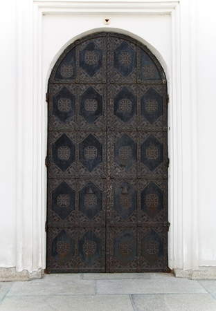Ornamented rusty ancient door. Old decoration of the door to Cathedral of the Dormition in Kiev Pechersk Lavra - famous monastery inscribed on UNESCO world heritage list. Ukrainian landmark.