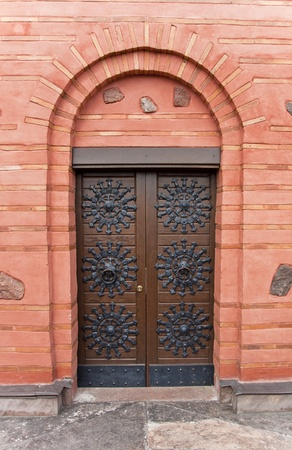 Ornamented wood ancient door. Old decoration of metal of the door of Gold Gate monument in Kyiv. Ukrainian landmark. photo