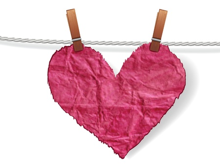 kindness: Heart crumpled ragged attached to a clothesline with pin. Love concept for valentine day.