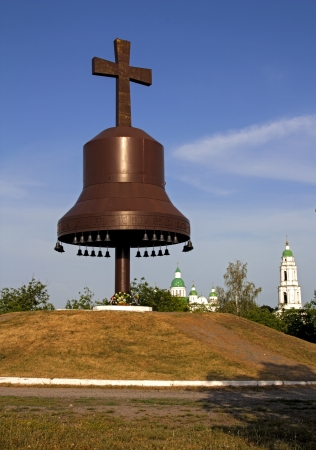 famine: Metal bells and cross symbol silhouette in Ukraine of Europe  Mgar orthodox male monastery and memorial to famine  holodomor  in country  Famous place near Lubny of Poltava region