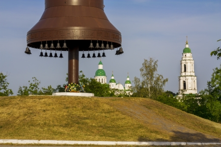 famine: Metal bells and cross symbol silhouette in Ukraine of Europe. Mgar orthodox male monastery and memorial to famine (holodomor) in country. Famous place near Lubny of Poltava region.