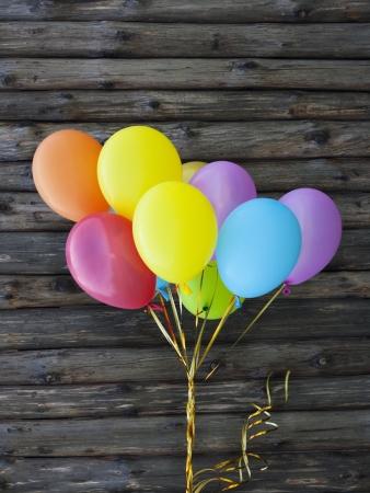 weather balloon: Balloon on wood background.  Stock Photo