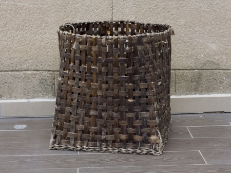 Basket for picnic or laundry made of rattan wattled photo  photo