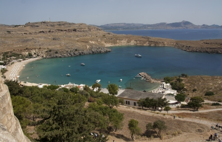View from above of the main water sea beach in Lindos on the Island of Rhodes Greece photo. Travel concept. photo