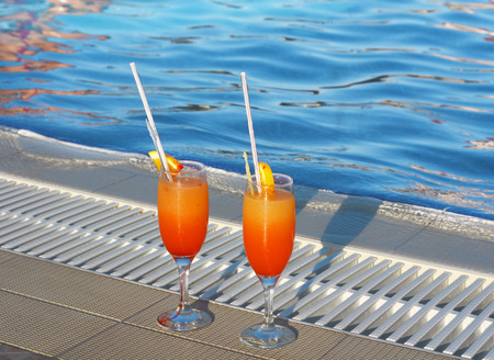 goblet: Cocktail near the swimming pool photo in hot day Stock Photo
