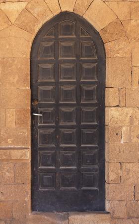 Ornamented wood ancient door photo