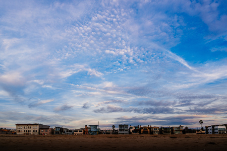 strand: Colorful clouds and the rising moon, over beachfront homes on The Strand in Hermosa Beach.