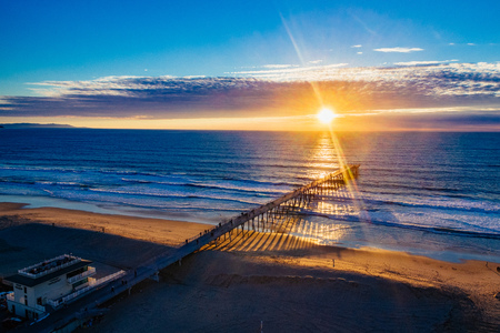 hermosa beach: Aerial view of the sun setting over the Hermosa Beach Pier and Pacific Ocean. Stock Photo