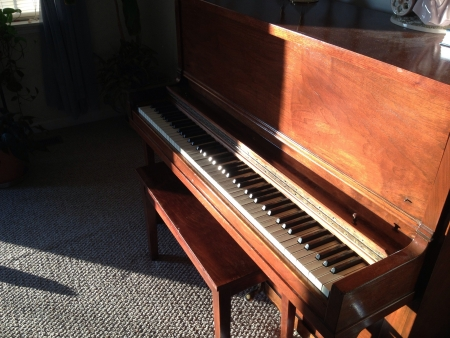 Antique piano with a lot of character.