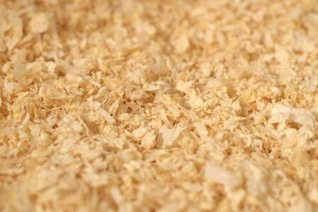 Close up texture of pine wood shavings, used as pet litter and bedding 写真素材