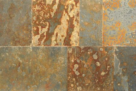 Close up of a wall made of rust colored square flagstones Stockfoto