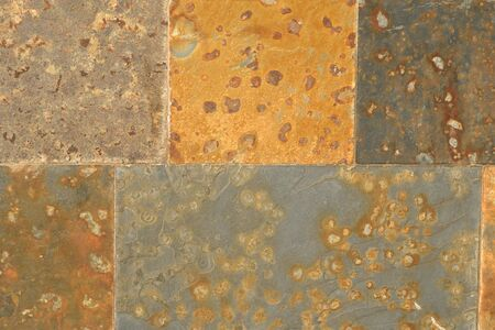 Close up of a wall made of rust colored square flagstones Stockfoto - 129457081