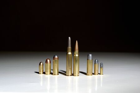 Organized crime family concept, bullets on a white surface with a black background Stock fotó
