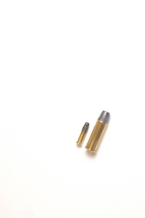 Penis size metaphor, phallic references. Two bullets, one small and one large. The small one is a .22 soft HP, the other a .44 Magnum
