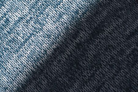 Mottled blue and white woollen sweater. Texture detail close up.
