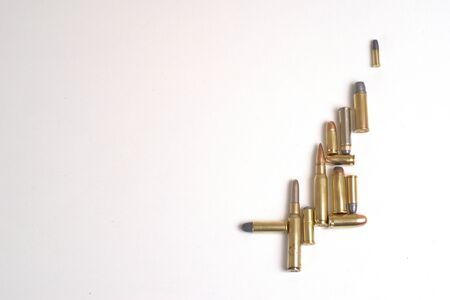 Collage of bullets of different calibers on a white background. There are several types of bullets: full metal jacket, soft point, round nose, flat nose, etc... Stock fotó
