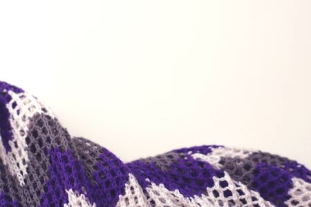 Purple and white striped pattern yarn crochet sweater. Texture detail close up. Negative space.