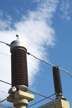 Ceramic insulators on a high voltage power line. Detail close up. Banque d'images - 130790472