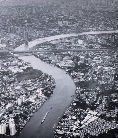 Aerial view of Bangkok, Thailand. and river Chao Phraya winding across the city. Black and white color toned vintage effect.