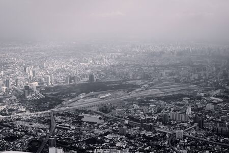Aerial view of Bangkok, Thailand, polluted air over the horizon. Urban sprawl, metropolis. Black and white color toned vintage effect.