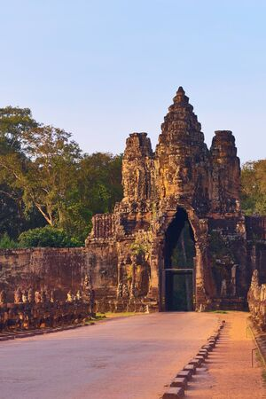 Face tower over the south gate of the ancient city of Angkor Thom, surrounding Angkor Wat temple complex, in Siem Reap, Cambodia.