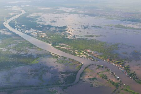Flooded farmlands village near Siem Reap, Cambodia. Aerial view.