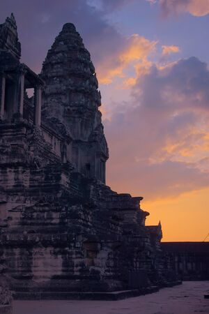 Angkor Wat temple at sunset. View of the northwest inner tower. Angkor Wat is the largest religious monument in the world, and has been declared World Heritage Site by UNESCO in 1992.