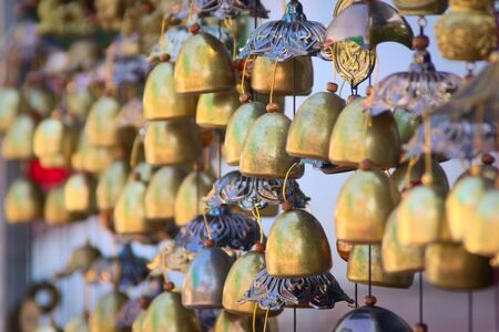 Traditional Lao chime bells at a stand in Luang Prabang, Laos. Фото со стока