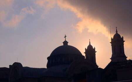 Church dome and christian crosses silhouetted against the afternoon sky in Istambul, Turkey.