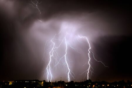 Lightning strikes at night during a severe thunderstorm over the city of Mendoza, Argentina Standard-Bild