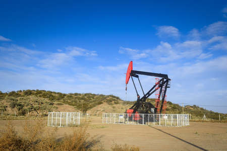 Oil extraction pumpjack in the desert of Mendoza, Argentina.