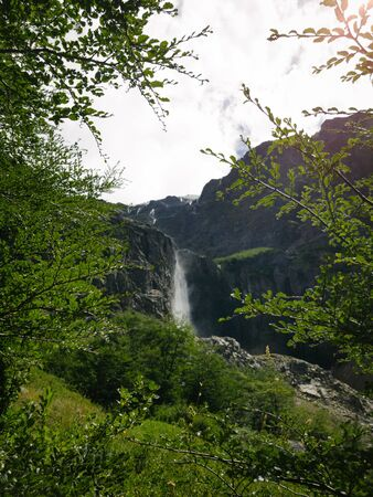 panoramic view of high waterfall at the end of trekking