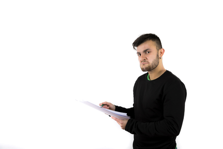Disapproving bearded young man holding some papers and pen isolated on a white background