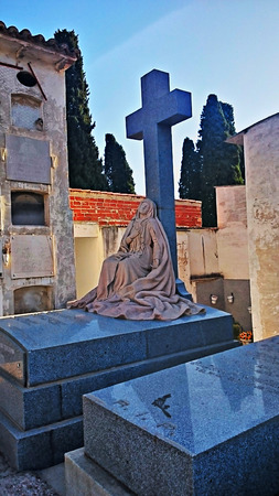 Funerary sculpture in a burial ground Stock Photo