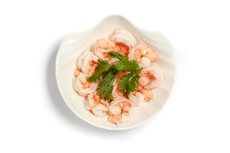 Shrimp salad in a plate with fresh garden vegetables