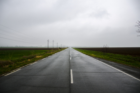 A lonely road in the middle of nowhere Stock Photo
